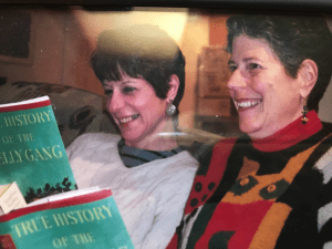 The author and her sister read Peter Carey together.