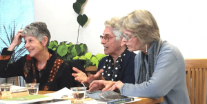From left, the author, poet Hilda Raz and novelist Lynn C. Miller