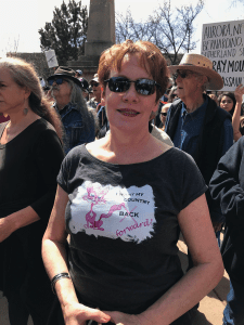Debbie Michelson wears her creative T-shirt at the Santa Fe rally for gun safety.