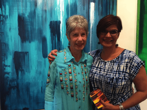 "Author Phyllis M Skoy, left, and Katyraven Hernandez Dorsey, the artist, at the literary art night, ""The House of Eternal Belonging"""
